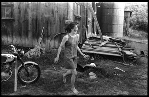 Cathy Rogers running barefoot past the barn, Montague Farm Commune