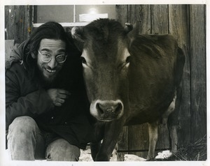 Marty Jezer (left) with Jersey cow at Packer Corners commune