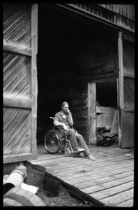 Peter Natti in his wheelchair, parked in the entrance to the barn, Montague Farm commune