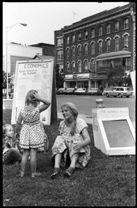 Betsy Corner and child at a solar energy demonstration, Greenfield Town Common