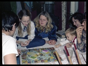 Playing a board game at Christmas time, Montague Farm commune