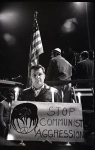 """Young Americans for Freedom pro-Vietnam War demonstration, Boston Common: Man holding sign reading """"Stop Communist aggression"""""""