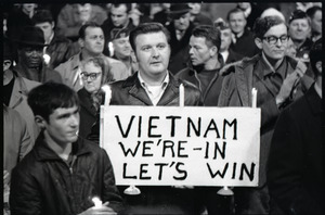 """Young Americans for Freedom pro-Vietnam War demonstration, Boston Common: Man holding sign reading """"Vietnam: we're in, let's win"""""""