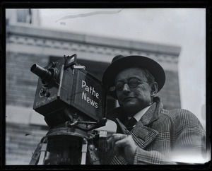 Dick Sears, Pathe News Service, with camera