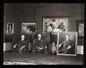 Caleb Arnold Slade portraits laid out in his studio