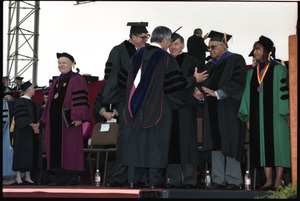 Ahmad Kathrada (2nd from right), on stage after receiving honor doctor of laws degree, UMass Amherst