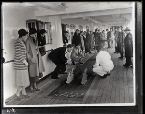 Crowd playing the horses on promenade deck of the St. John steamship