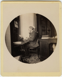 C.P. Blanchard typing at his desk