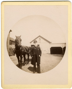Albert Henry Blanchard standing by horse and carriage