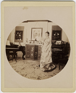 Abby F. Blanchard in the parlor, with fan and kimono