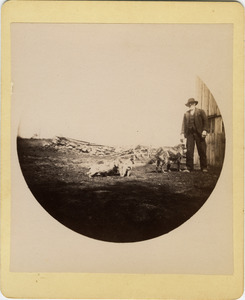 Unidentified man and dogs