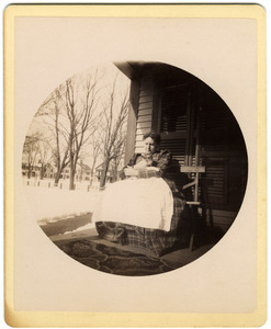 Mary Brown seated on porch with cat