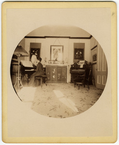 Annie Blanchard playing the piano forte in the parlor