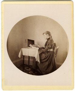Abby F. Blanchard operating a card punching machine