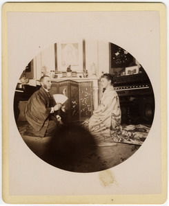 C. P. Blanchard and Abby F. Blanchard seated on the parlor floor, wearing kimonos