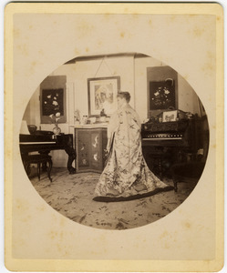 Abby F. Blanchard in the parlor, from behind, wearing a kimono