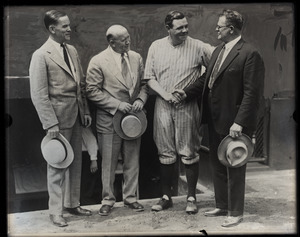 Babe Ruth in uniform with three unidentified men