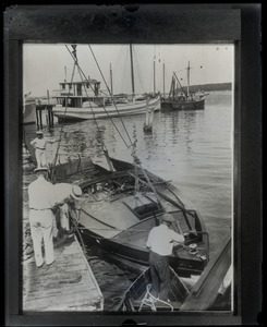 Burned hull of the motorboat owned by Harry Richman in which a party of Ziegfield Follies and other Broadway principals narrowly escaped death when the gasoline tank exploded