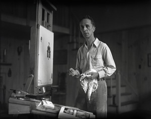 Norman Rockwell standing at an easel, painting