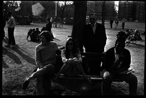 Crowd on Cambridge Common: people seated on a park bench