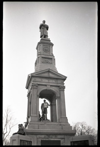 Crowd on Cambridge Common: Civil War Memorial (statue of Abraham Lincoln hung with sign advertising the opening of the Cambridge Electric Ballroom)