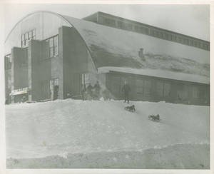 Children Sledding Outside the Memorial Field House