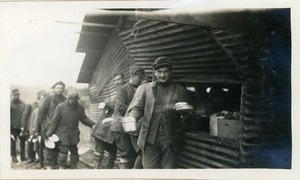 Chow line: American soldiers with mess kits in line for a meal