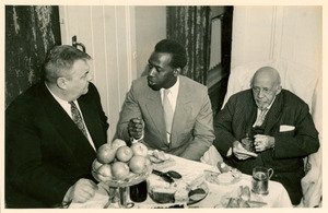 W. E. B. Du Bois and others gathered around table in Soviet Union