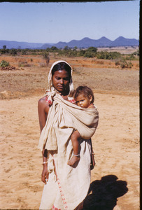 Birhor mother with child in a sling