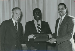 Unidentified man presenting Division of Public Health School of Health Sciences Award of Recognition to Randolph W. Bromery, and William Alexander Darity