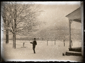 Boy in falling snow (Greenwich, Mass.)