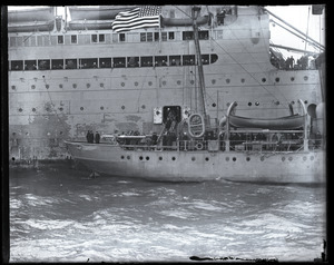 Woodrow Wilson's return from the Paris Peace Conference: members of Wilson's entourage debarking from the George Washington onto the Coast Guard cutter Ossipee for transport to Commonwealth Pier in South Boston (copy image)