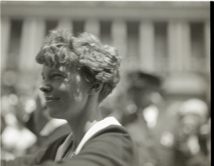 Amelia Earhart reception: close-up of Earhart riding in a car in front of the Massachusetts State House