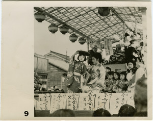 Women and children atop float in a matsuri procession