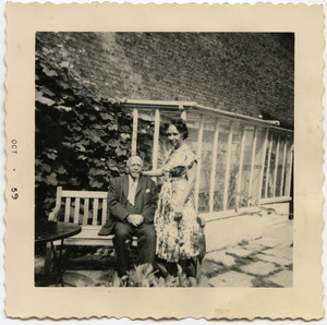 W. E. B. Du Bois and Shirley Graham Du Bois seated on a bench