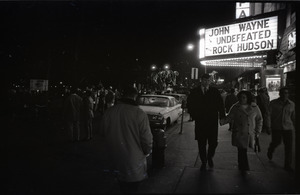 Young Americans for Freedom pro-Vietnam War demonstration, Boston Common: Crowd in front of movie theater showing John Wayne's Undefeated