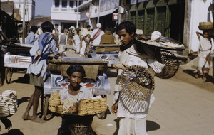 Carrying trays of sweetmeats to sell at the market in Ranchi