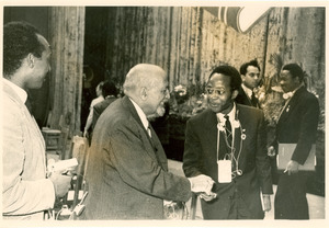 W. E. B. Du Bois greeting unidentified delegate, Afro-Asian Writers Conference, Tashkent, 1958