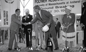 Ceremonial groundbreaking: group including Gov. William Weld (center) shaking hands with unidentified man, Stanley Rosenberg to Weld's right and Corinne Conte to his left