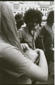 Abbie Hoffman walking in Harvard Square, talking with young woman (Church of the Final Judgment)