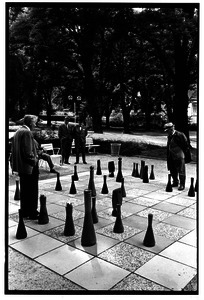 Men playing outdoor chess