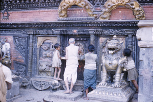 People making offerings at shrine