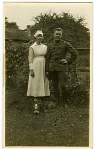 Lawrence D. Yeomans, in uniform, standing with unidentified nurse and bulldog