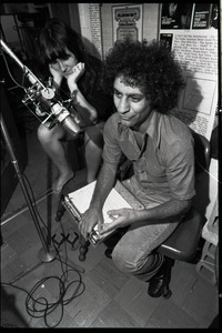 Abbie Hoffman: unidentified woman and Hoffman (right) at the microphone, WBCN