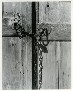 Wooden door with lock and chain