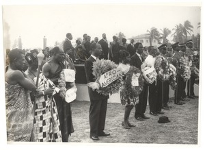 Officials of the Ghanaian government stand on a dais at the state funeral of W. E. B. Du Bois