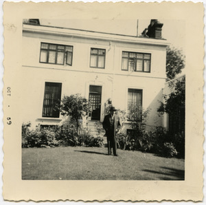 W. E. B. Du Bois standing in front of an unidentified house