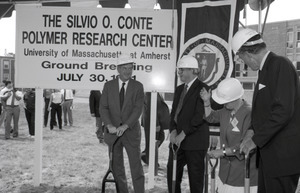 Ceremonial groundbreaking for the Conte Center: Gov. William Weld, UMass Amherst Provost Richard O'Brien, Corrine Conte, and unidentified man preparing for ceremonial first shovel