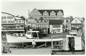 Harbor buildings and stout man