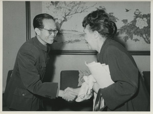 Shirley Graham Du Bois shaking hands with unidentified Chinese official